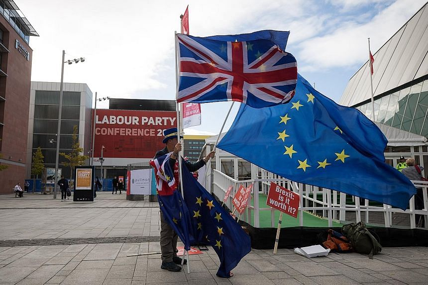 An anti-Brexit campaigner in Liverpool on the closing day of the annual Labour Party conference in the British city yesterday.