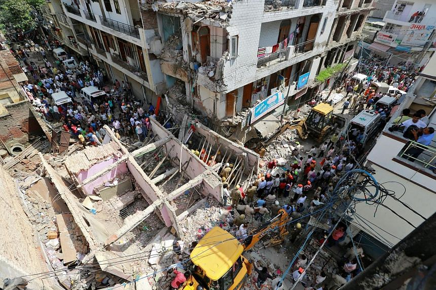 Rescuers searching for survivors in the collapsed building, which was located in a cramped, middle-class neighbourhood where many buildings share common walls.