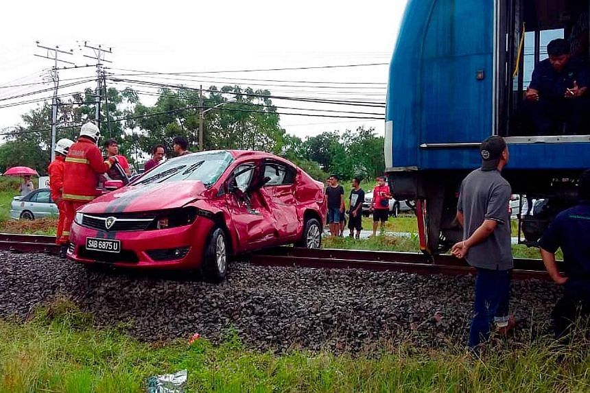 This Proton Preve car collided with a train in rainy weather at a rail crossing near Petagas township in Kota Kinabalu and was dragged for about 200m, along with the two men inside.