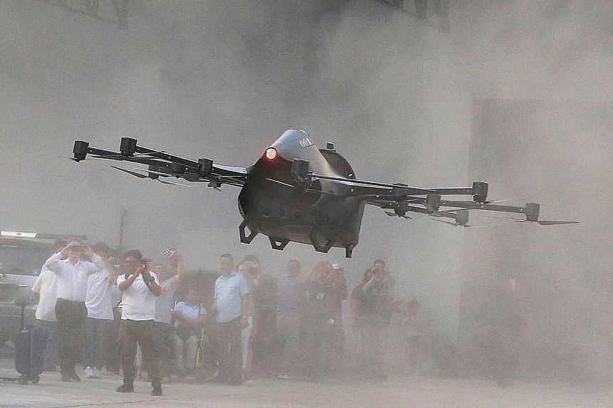 Philippine inventor Kyxz Mendiola testing what he calls his flying sports car in the province of Batangas, Philippines. His machine, the Koncepto Milenya, can fly as high as 6.1m and with a speed of up to 60kmh, although its maiden flight lasted just
