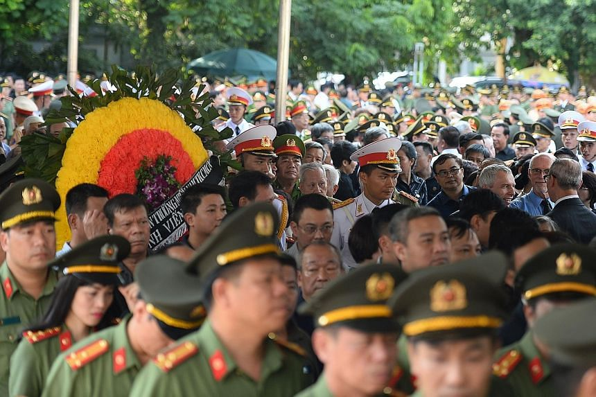The state funeral drew tearful members of the public as well as monks. The President will be buried in his home town in Ninh Binh province today. Vietnamese police officers queueing to pay their last respects to the late President Tran Dai Quang in H