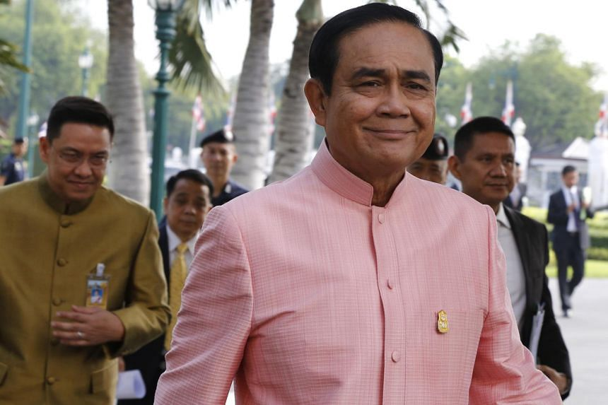 Thai Prime Minister Prayut Chan-o-cha (left) arrives for a weekly cabinet meeting at the Government House in Bangkok, Thailand, on Sept 25, 2018.