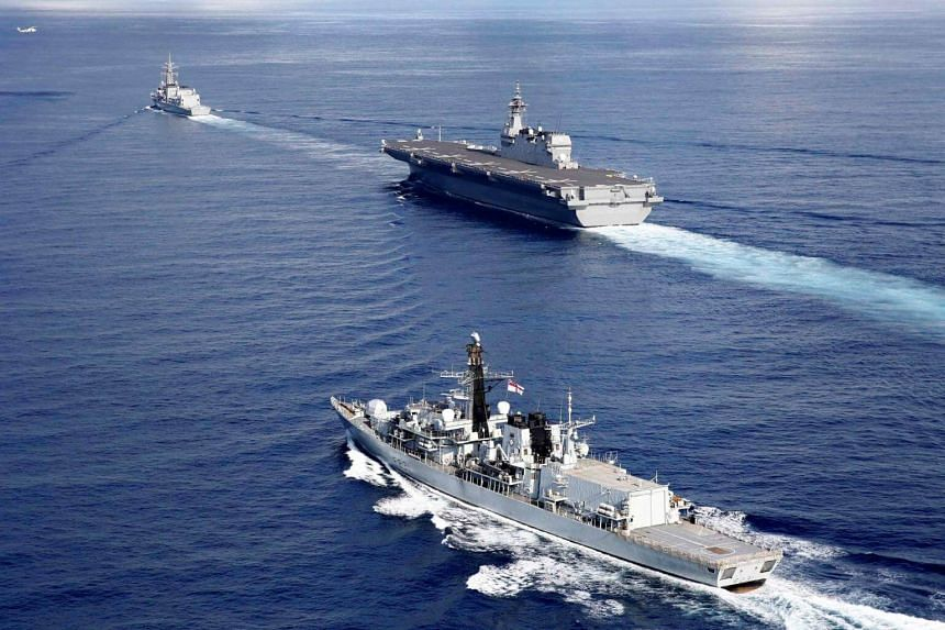 British frigate HMS Argyll (front), Japanese helicopter carrier Kaga (centre) and Japanese destroyer Inazuma take part in a joint naval drill in the Indian Ocean, on Sept 26, 2018.