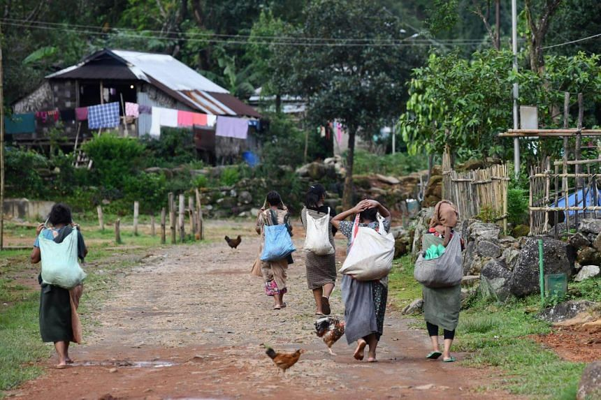 Indian villagers returning from a day's work in Kongthong village, in India's eastern Meghalaya state.