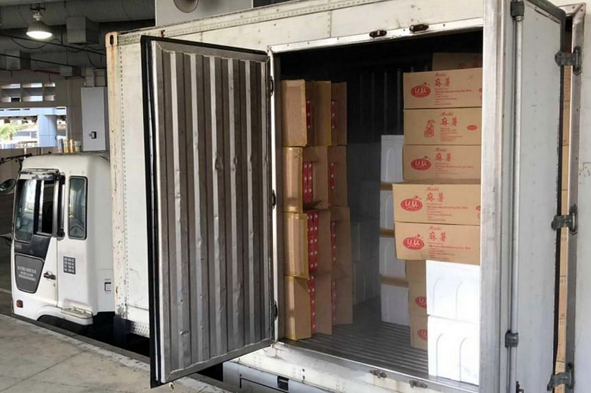 The lorry was carrying a consignment that was declared to be frozen food, but Immigration and Checkpoints Authority officers uncovered the cartons of duty-unpaid cigarettes during further checks.