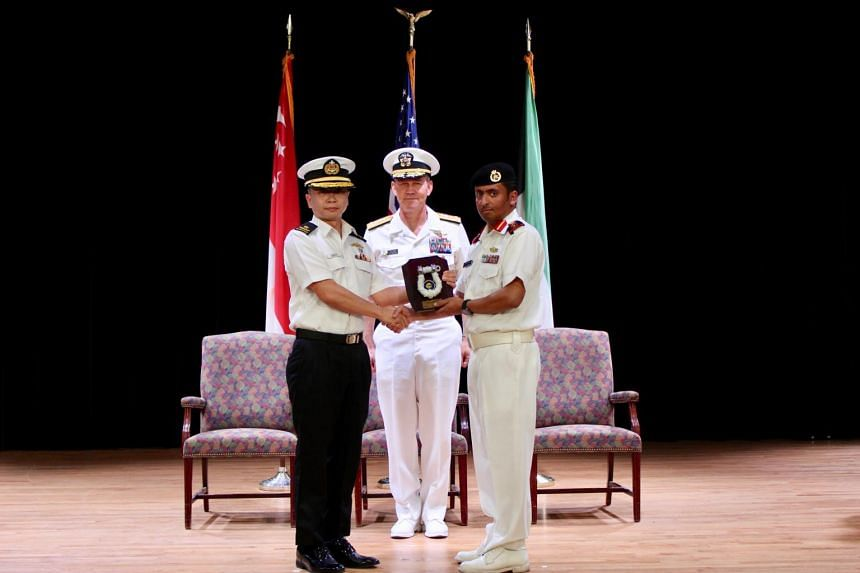SAF's Rear-Admiral Saw Shi Tat (left) handed over command of CTF 151 to Captain Ali Alrashidi of the Kuwait Naval Force in Bahrain, in a ceremony witnessed by Commander of Combined Maritime Forces, Vice-Admiral Scott Stearney.