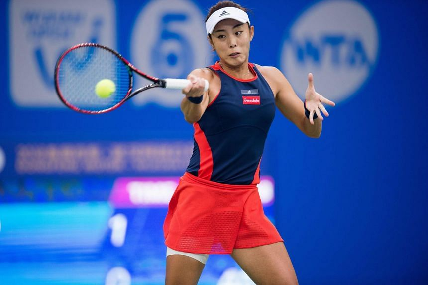 Wang Qiang of China hits a return during the women's singles quarter-final match at the WTA Wuhan Open tennis tournament in Wuhan, on Sept 27, 2018.