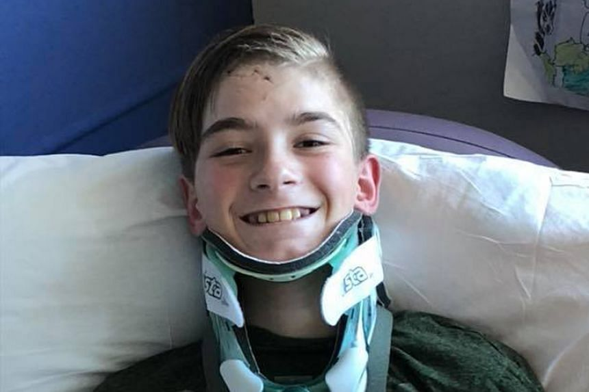 Austyn Kerley, 13, was saved during a car accident when his grandfather used his body to shield him.