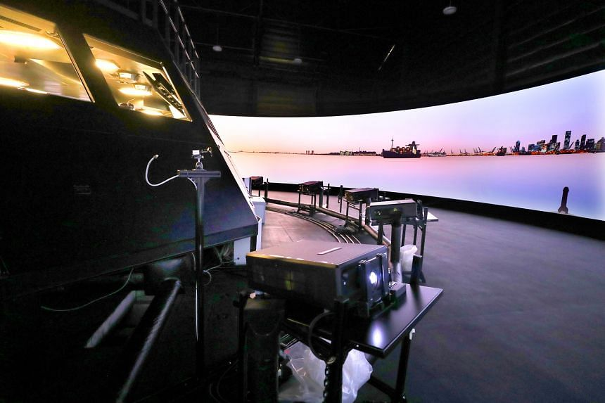 Fifteen projectors placed around a hall at the RSS Daring-Littoral Mission Vessel Simulation Centre replicate a 360-degree view around a ship for more realistic training.