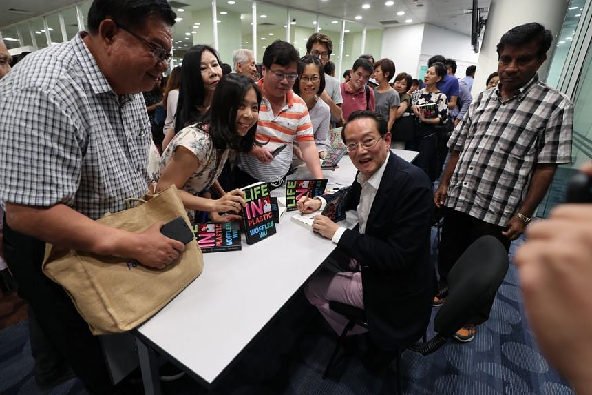 Plastic surgeon and author Woffles Wu at a book signing after his talk at the seventh edition of The Straits Times Book Club held at the National Library.