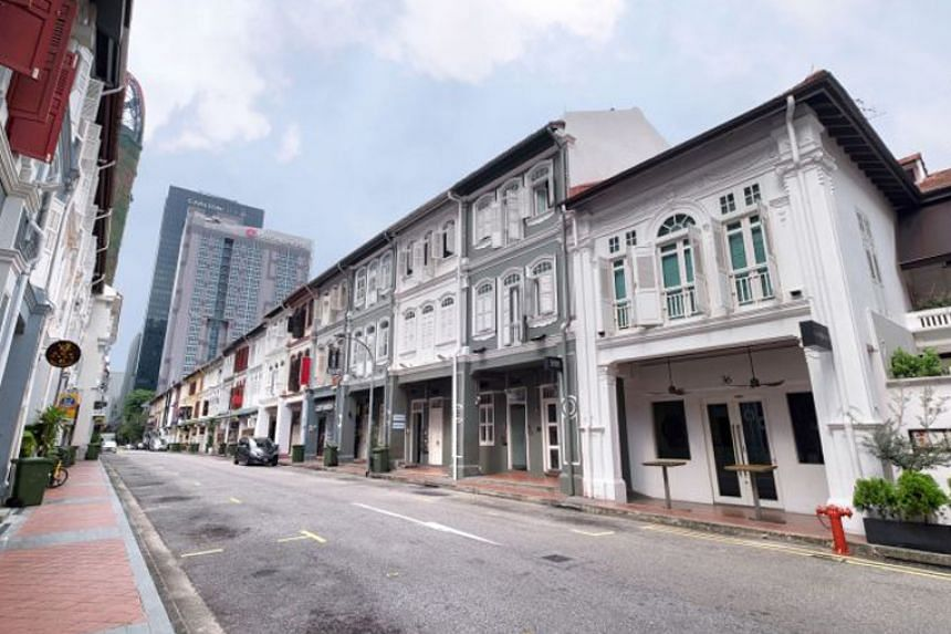 The two three-storey conservation shophouses in Tras Street that are up for sale have a guide price of about $2,800 per square foot based on gross floor area.