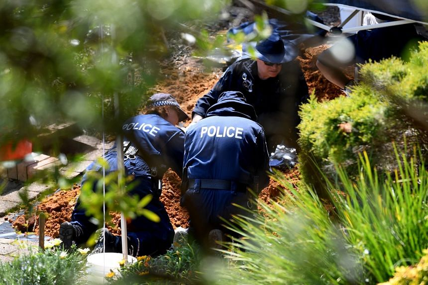 Police and forensic personnel (above) sifting through dirt for clues on Sept 12 as they searched the former home of Ms Lynette Dawson, who vanished 36 years ago.
