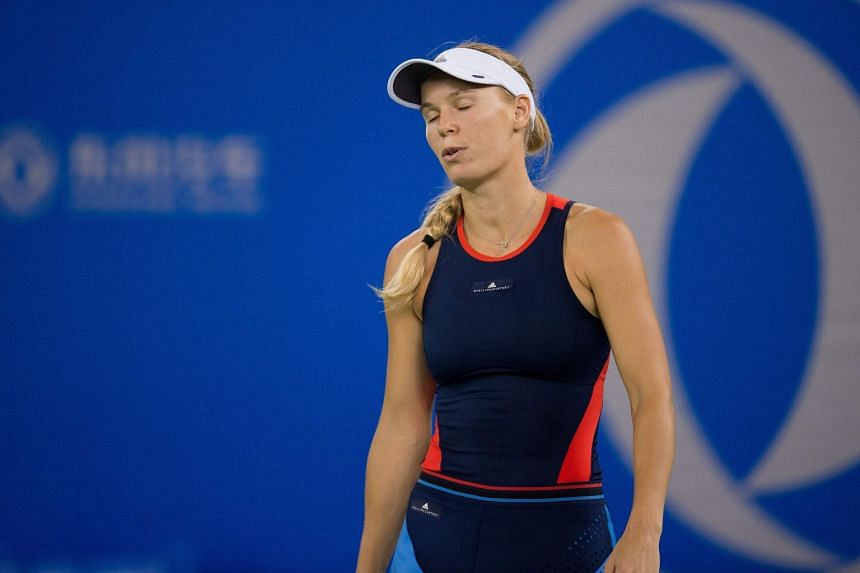 Wozniacki reacts after losing a point against Monica Puig of Puerto Rico.