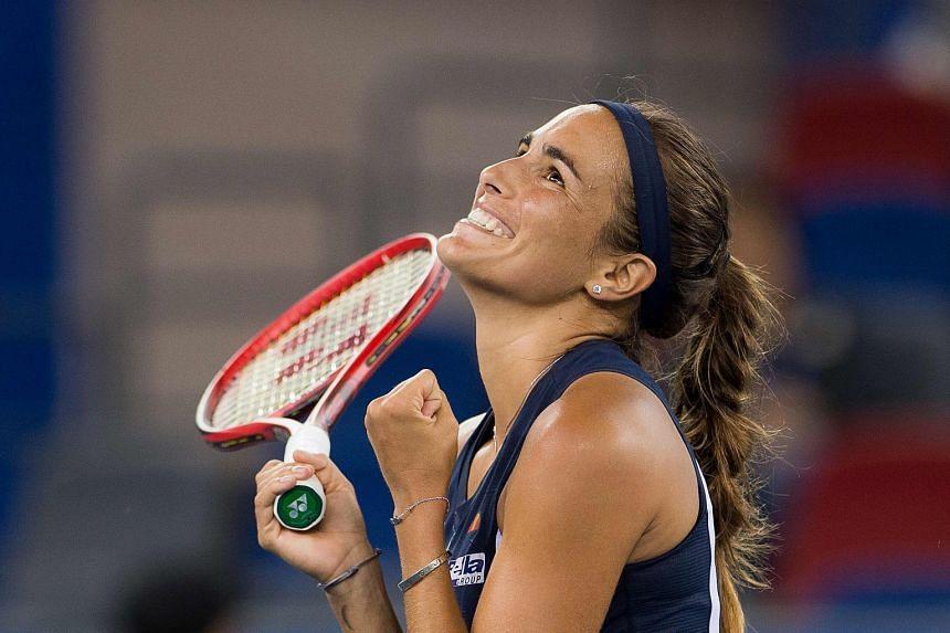 Monica Puig celebrates winning against Caroline Wozniacki.