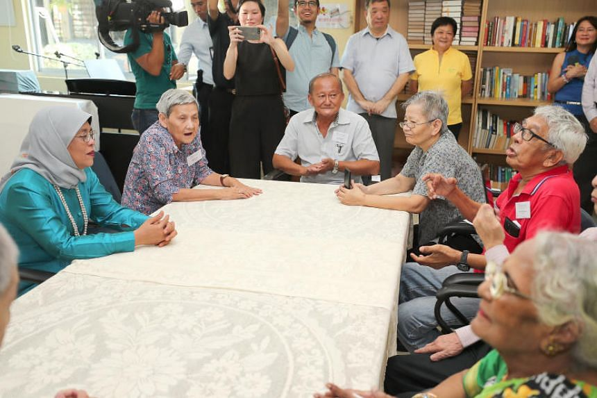 President Halimah Yacob fielded questions from residents of the St John's Home for Elderly Persons during a visit there.