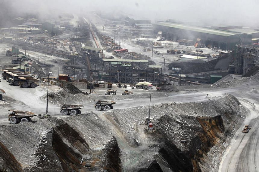 A file photo taken on Sept 19, 2015, shows trucks parked at the open-pit mine of PT Freeport's Grasberg copper and gold mine complex near Timika, in Indonesia's Papua province.