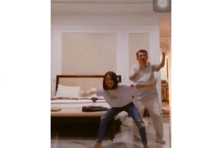 In the 20-second clip, Vice-President Jusuf Kalla's granddaughter Jamila is seen filming herself dancing to Dutch rapper Dopebwoy's song Cartier, when Mr Kalla enters the room and joins her.
