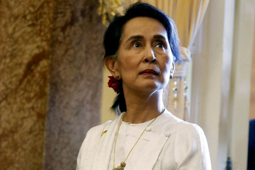 Myanmar's civilian leader Aung San Suu Kyi (above) has been stripped of her honorary citizenship.