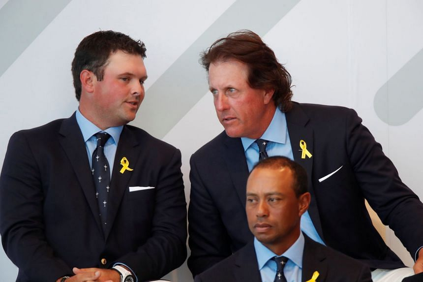 Team USA's Patrick Reed, Phil Mickelson and Tiger Woods during the Ryder Cup opening ceremony.