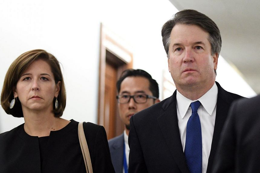 Mr Kavanaugh and his wife Ashley arrive for his Senate Judiciary Committee confirmation hearing in Washington.