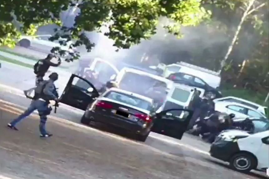 A video grab shows Dutch police special forces arresting a suspect in Weert, Netherlands.