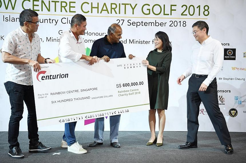 Above: (From left) Centurion Group principals David Loh and Han Seng Juan, and Home Affairs and Law Minister K. Shanmugam presenting a cheque to Rainbow Centre Singapore executive director Tan Sze Wee and vice-president Chew Kei-Jin. Right: (From lef