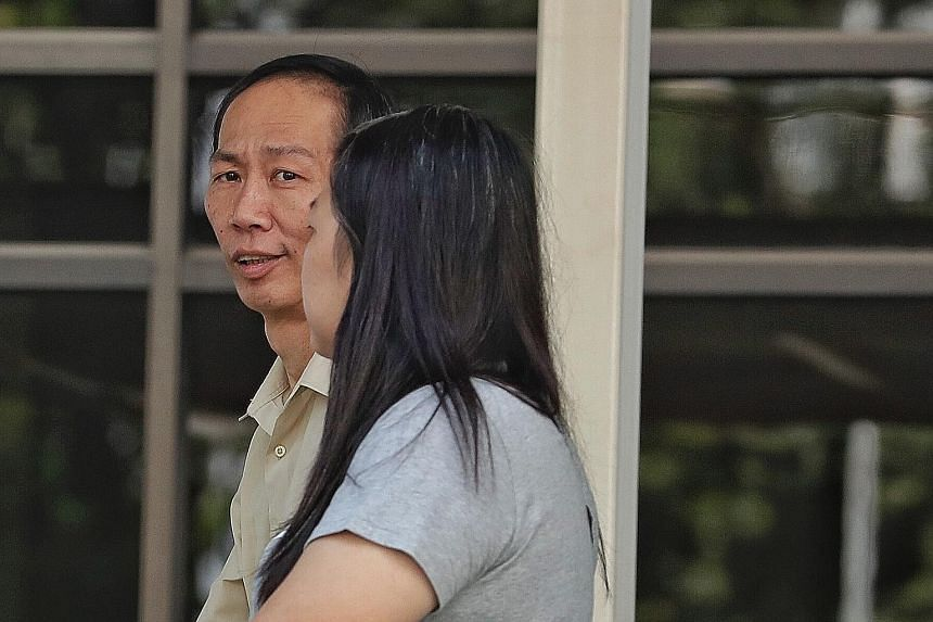 Immigration and Checkpoints Authority officer Chin Peng Sum with his wife Lee Lay Chin. Aside from allegedly receiving sexual gratification from two Chinese women, he is also accused of sharing information with them and two others about impending rai