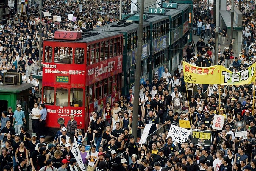People taking to the streets of Hong Kong in July 2003 to protest against the implementation of Article 23, a controversial anti-subversion law.