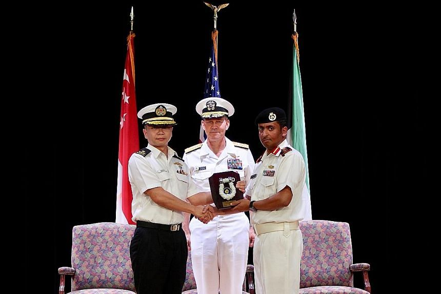 Rear-Admiral Saw Shi Tat handing over command of Combined Task Force 151 to Captain Ali Alrashidi of the Kuwait Naval Force in Bahrain yesterday, witnessed by Commander of Combined Maritime Forces US Vice-Admiral Scott A. Stearney.