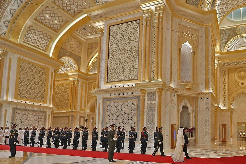 Chinese President Xi Jinping and Crown Prince of Abu Dhabi Sheikh Mohamed bin Sayed Al Nahyan reviewing the honorary guards at the presidential palace in the UAE capital in July. Mr Xi's UAE visit was one of the recent indicators of how much relation