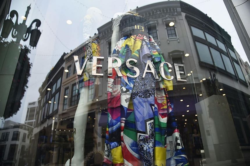 Michael Kors will look to grow Versace's (above) sales of accessories like handbags, leather goods and shoes.