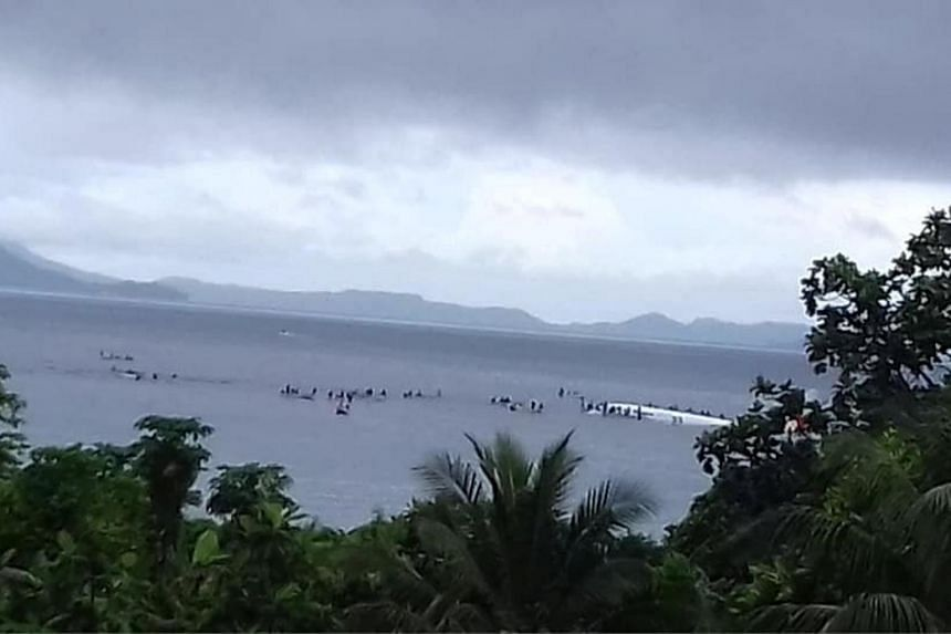 People are evacuated from an Air Niugini plane which crashed in the waters in Weno, Chuuk, Micronesia, on Sept 28, 2018.