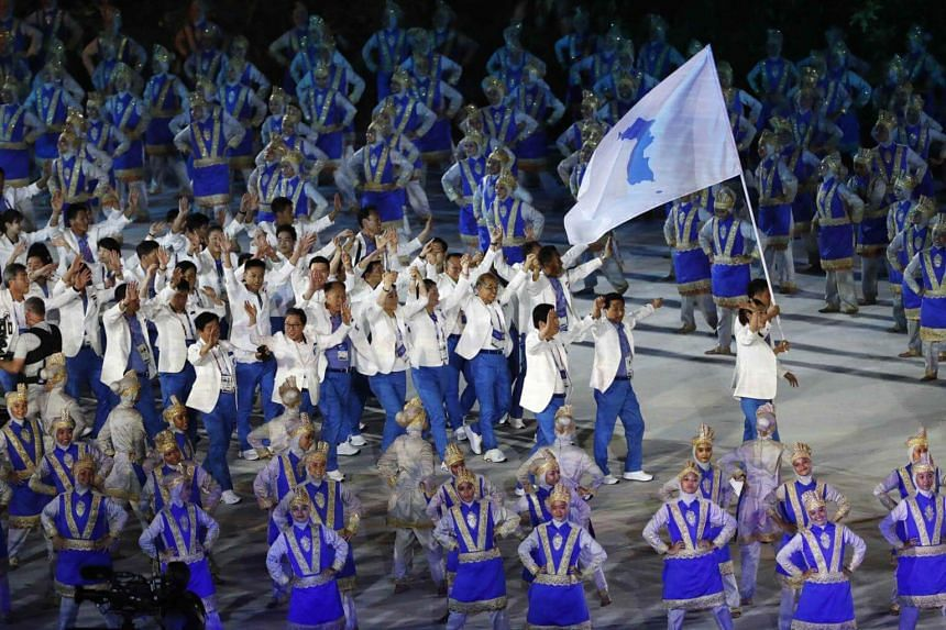 Athletes from the Unified Korea team marching in Jakarta's Gelora Bung Karno Stadium, on Aug 18, 2018.