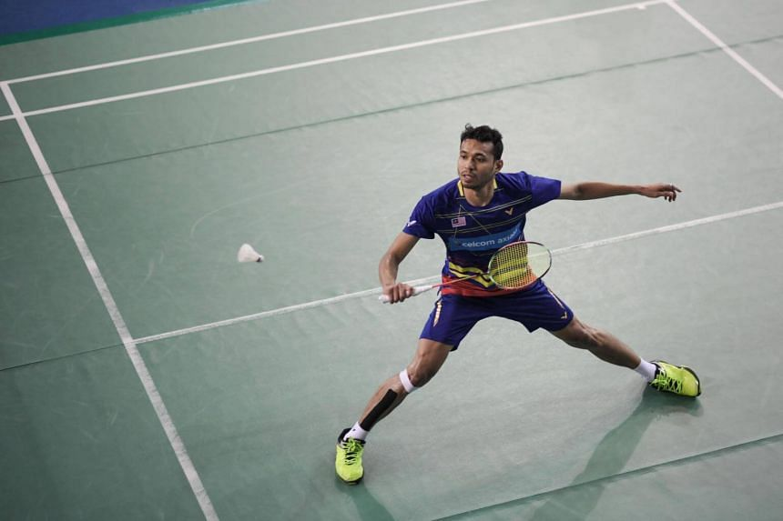 Iskander Zulkarnain of Malaysia returns a shot during his second round men's singles qualification match of the Korea Open badminton tournament in Seoul, on Sept 25, 2018.