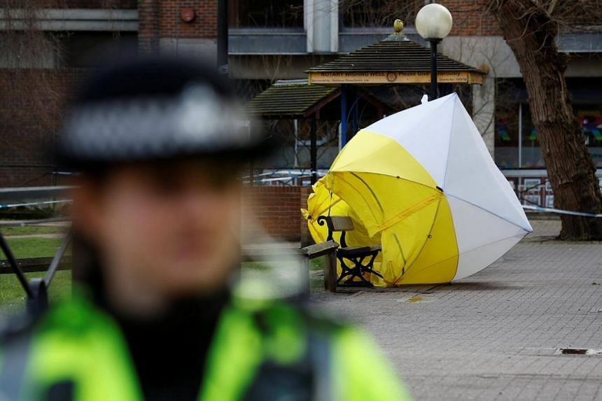 A forensic tent covering the bench where Sergei Skripal and his daughter Yulia were found, in Salisbury, Britain, on March 8, 2018.