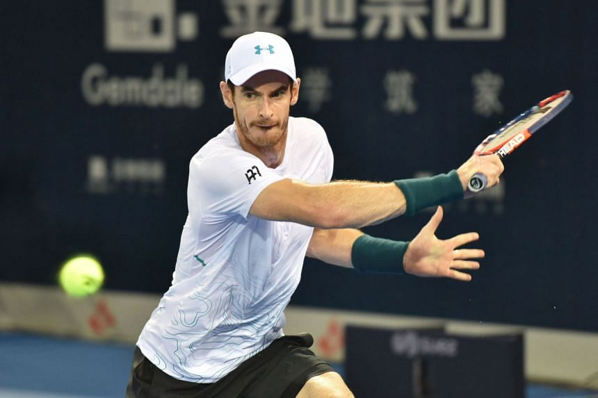 Britain's Andy Murray hitting a return during his match against Belgium's David Goffin (not pictured) at the ATP Shenzhen Open tennis tournament in Shenzhen, China, on Sept 27, 2018.