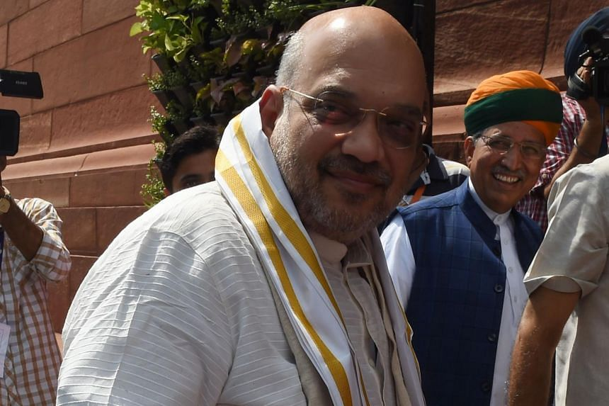 """Mr Amit Shah, the head of Indian Prime Minister Narendra Modi's Bharatiya Janata Party, spoke approvingly of one """"smart"""" social media volunteer who spread a fake rumour over WhatsApp during a state election in 2017."""
