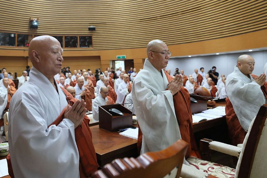 Seoljeong (left), president of South Korea's Buddhist Jogye Order, attends its central committee at the Jogyesa temple in Seoul on Aug 16, 2018.