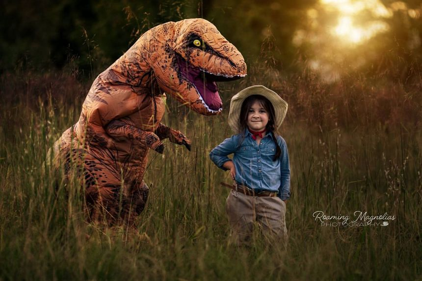 Eight-year-old Levi's mother dressed him up in a dinosaur costume so that he would enjoy having his photo taken, despite having autism.