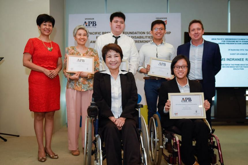 (Clockwise from left) Ms Indranee Rajah, Minister in the Prime Minister's Office, Mrs Lee Sok Fun, mother of scholarship winner Lionel Lee, Mr Caleb Tay, Mr Justin Kueh, Mr Andy Hewson, managing director of Asia Pacific Breweries Singapore, Ms Brenda