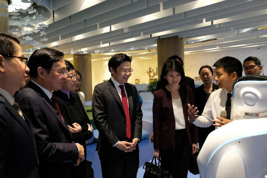 Minister for National Development Lawrence Wong (centre) at the China-Singapore Friendship Library on Sept 28, 2018. With him are (from left) Singapore's ambassador to China Stanley Loh, Tianjin Binhai New Area party chief Zhang Yuzhuo, vice minister