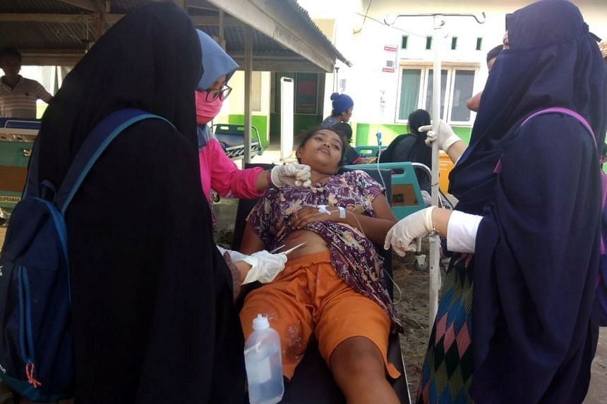 A resident receiving medical treatment in Donggala after the earthquake.