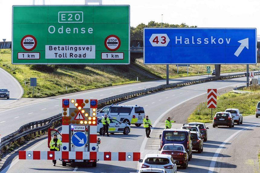Danish police set up a barrier before the Great Belt Bridge in Korsoer, Denmark.