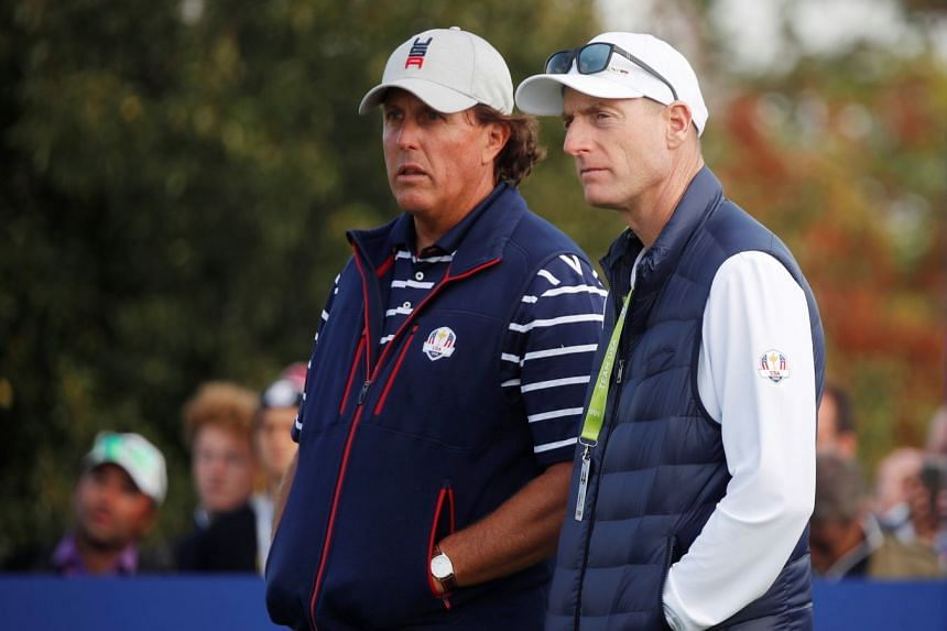 Team USA captain Jim Furyk and Team USA's Phil Mickelson during the Foursomes.
