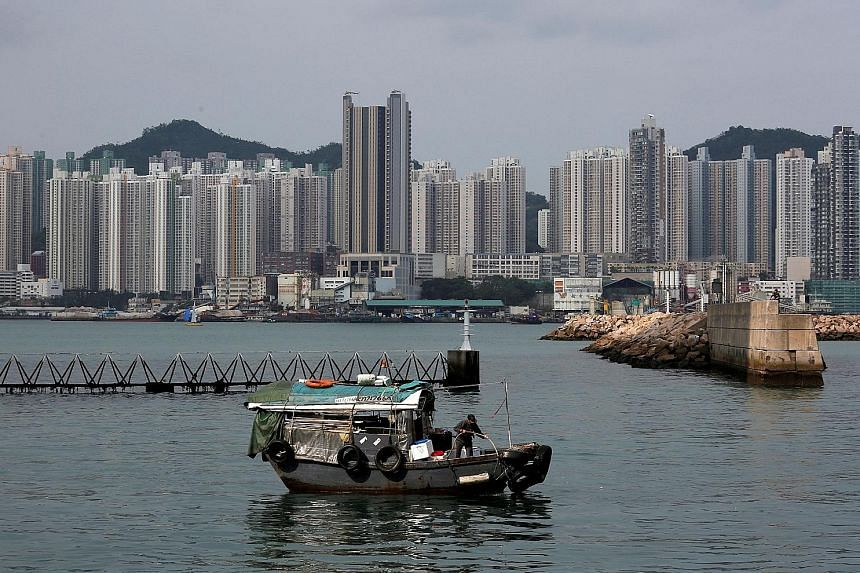 Ultra low interest rates, limited housing supply and large flows of capital from mainland Chinese buyers have helped push Hong Kong housing prices up 165 per cent over a decade, prompting repeated warnings from the authorities about the risks of an a