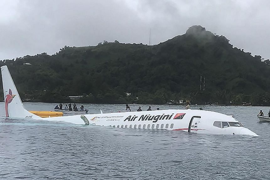 Passengers were forced to swim for their lives yesterday when an airliner ditched into a lagoon after missing the runway on a remote Pacific island and immediately began sinking. The Air Niugini Boeing 737 was attempting to land at Weno airport in Mi