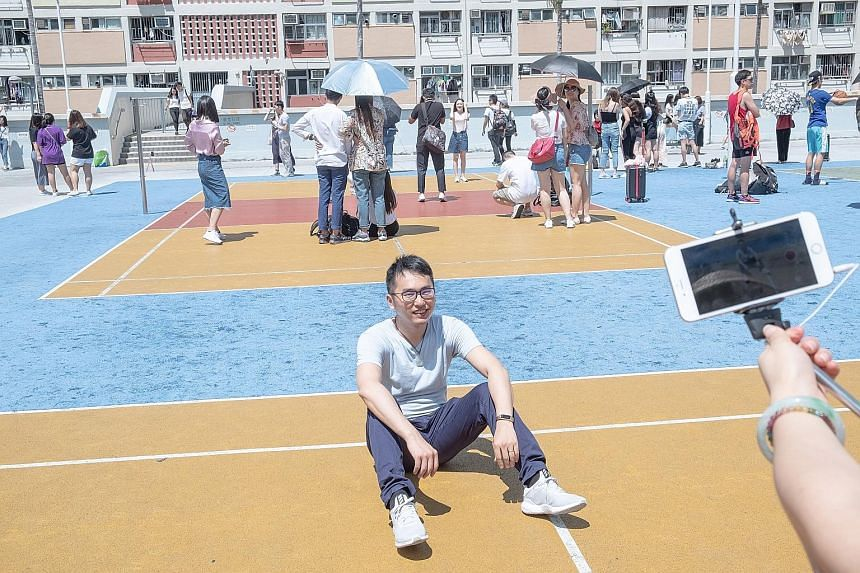 It is difficult to start a game of basketball in Choi Hung Estate, with visitors standing or sitting on the courts for photos.