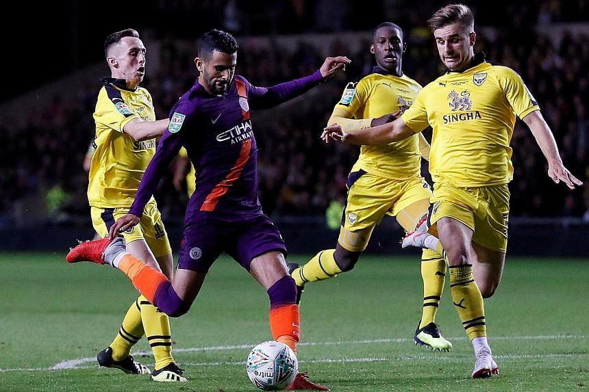 Manchester City's Riyad Mahrez (in blue) scored in their 3-0 midweek League Cup win at Oxford United. It was his third goal in two games.