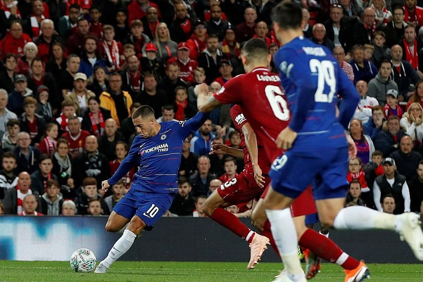 Eden Hazard putting his angled shot into the far corner, having taken possession in central midfield and managing to overcome several challenges. The goal gave Chelsea a 2-1 League Cup win at Liverpool on Wednesday.
