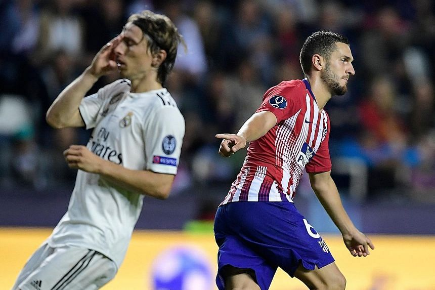 Koke celebrates scoring a goal to seal Atletico's 4-2 extra-time win in the Uefa Super Cup last month as Real Madrid's Luka Modric shows his anguish.